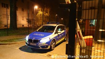 A German police car leaving the Bamberg site