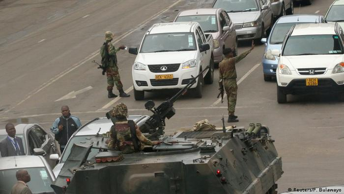Military vehicles and soldiers patrol the streets in Harare