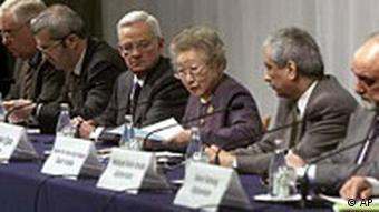 Chairperson Sadako Ogata, third from right, opens a joint press conference in Tokyo following the Afghan Reconstruction Conference Tuesday Jan. 22, 2002. From left to right are, the conference co-chairs, European Commission External Relations Commissioner Christopher Patten, Spanish Secretary of State for Foreign Affairs Miguel Nadal, U.S. Treasury Secretary Paul O'Neill, Ogata, Saudi Arabian Minister of Finance Ibrahim bin Abdul-Aziz Al-Assaf, and Afghan Minister of Finance Hedayat Amin Arsala. The conference closed Tuesday with pledges of more than 4.5 billion U.S. dollars for war-torn Afghanistan. (AP Photo/David Guttenfelder)