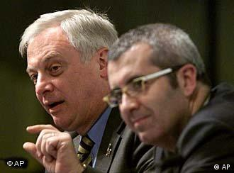 European Commission External Relations Commissioner Christopher Patten, left, speaks during a joint press conference in Tokyo following the Afghan Reconstruction Conference Tuesday, Jan. 22, 2002. On the right is Spanish Secretary of State for Foreign Affairs, Miguel Nadal. The two-day conference closed Tuesday with pledges of more than 4.5 billion US dollars for war-torn Afghanistan. (AP Photo/David Guttenfelder)