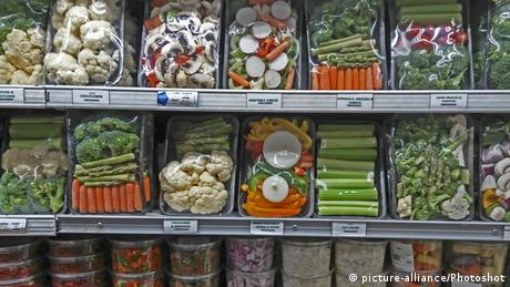 Shelves of chopped vegetables in plastic trays