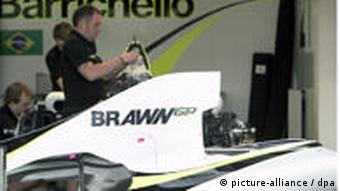 Mechanics of the new Formular One team Brawn GP work in the garage at the Albert Park Circuit in Melbourne, Australia.
