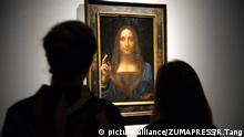 October 24, 2017 - London, London, UK - Christies staff members views a painting titled Salvator Mundi (1490) by artist Leonardo da Vinci with an estimate in excess of 00 million. The painting of Christ as Salvator Mundi was recently attributed to Leonardo da Vinci, who is known to have painted the subject. It was lost and later rediscovered, and restored and exhibited in 2011 |