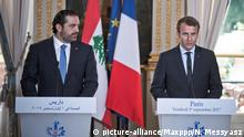Frankreich Emmanuel Macron & Saad Hariri in Paris (picture-alliance/Maxppp/N. Messyasz)