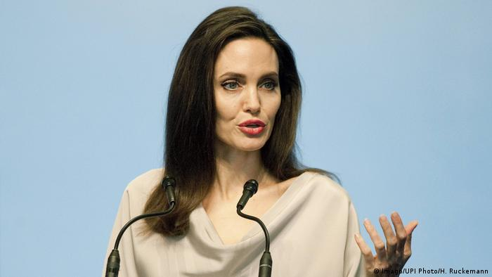 Angelina Jolie speaking at a podium