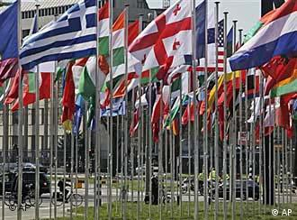 Forest of international flags outside Hague convention centre