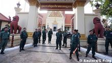 Police stand guard outside Cambodia's Supreme Court