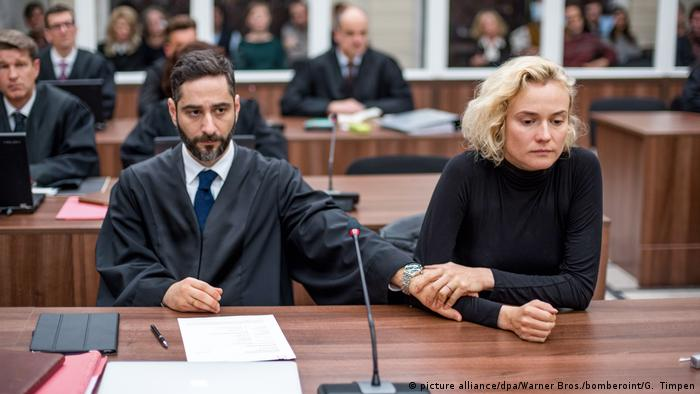 Film still 'In the Fade,' by Fatih Akin shows lawyer and women in a courtroom (picture alliance/dpa/Warner Bros./bomberoint/G. Timpen)