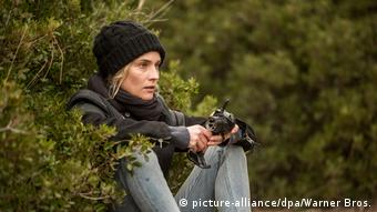 Scene from the film with Diane Kruger sitting amidst trees (picture-alliance/dpa/Warner Bros.)