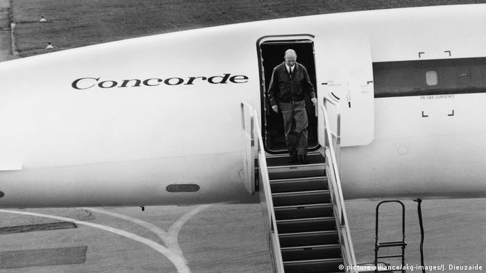Andre Turcat, first Concorde pilot, disembarks from a plane