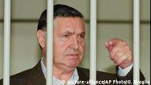 Former mafia boss Toto Riina is seen behind bars during a trial in Rome