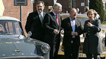Chancellor Merkel inspects historic Opel models.
