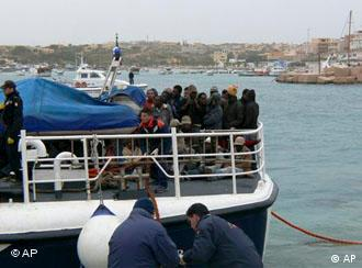 An Italian Coast Guard boat carrying some would-be immigrants, rescued at sea, reaches the port of the tiny Italian island of Lampedusa in this March 29, 2009 photo made available