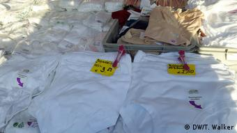 Large white knickers laid out on market stall