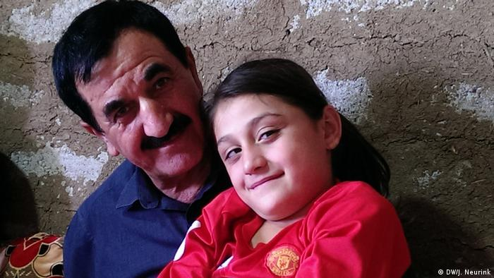 Yazidi father and daughter