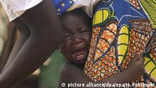 epa03310970 A picture made available on 19 July 2012 shows a young boy cries as he holds onto his mother on the terrain of a refugees camp near Dori, Burkina Faso, on 04 July 2012. According to reports, over 370,000 people have been displaced by the violence in Mali and continue to cross the borders into the hunger-stricken Burkina Faso and Niger. EPA/HELMUT FOHRINGER |