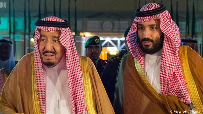 Saudi Arabia's King Salman bin Abdulaziz Al Saud walks with his son and Crown Prince Mohammed bin Salman