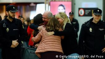 The mayor of Caracas, Antonio Ledezma hugs his wife Mtzy Capriles and his daughter