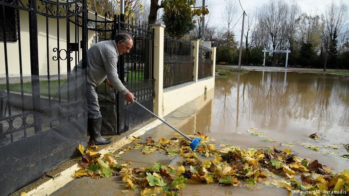 Man cleaning his doorstep