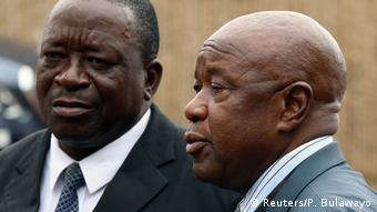 A portrait of Zimbabwean War Veterans leader Chris Mutsvangwa on the right