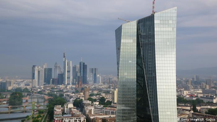 The new headquarters of the European Central Bank (ECB) stands in the foreground as the financial district and skyline of central Frankfurt