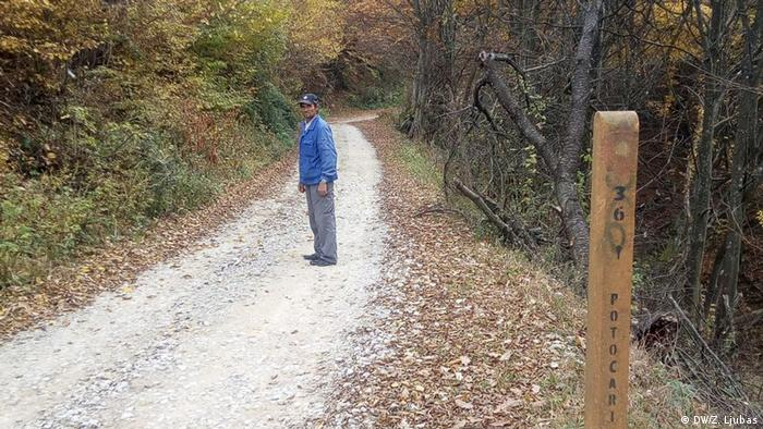 Ramiz standing on a road