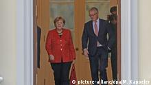 Angela Merkel departs from a meeting with the German president