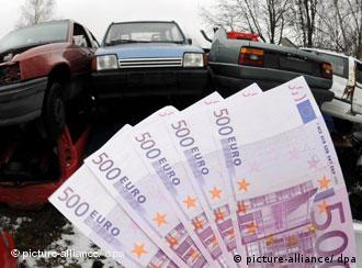 A bundle of euro notes and several cars