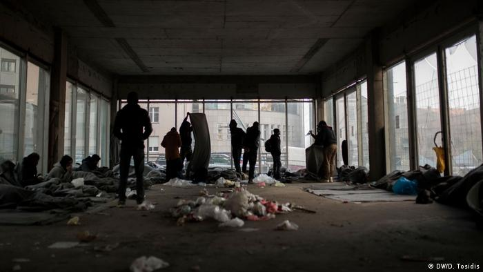 Unregistered refugees and migrants sleep in an abandoned building in Belgrade