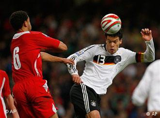 Germany's Michael Ballack, right, and James Collins of Wales challenge for the ball during the soccer World Cup qualifying group 4 match between Wales and Germany at the Millennium Stadium in Cardiff, Wales Wednesday April 1,2009.