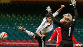 Germany's Mario Gomez, centre, lunges for a header against Wales' goalkeeper Wayne Hennessey during their World Cup group 4 qualifying soccer match at The Millennium Stadium, Cardiff, Wales, Wednesday April 1, 2009.