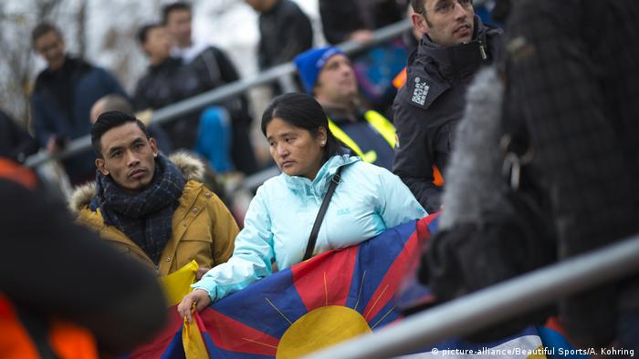 An activist waves a Tibetan flag at a friendly U-20 China-Germany match in Mainz