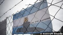 An Argentine national flag with messages in support of the 44 crew members of the ARA San Juan submarine missing at sea is seen placed on a fence (Reuters/M. Brindicci)