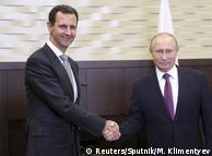 Башар Асад (ліворуч) та Володимир Путін у Сочі