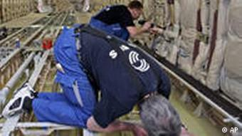 Workers fit out an Airbus plane
