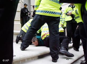 A man is detained outside the London Stock Exchange