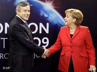 British Prime Minister Gordon Brown greets German Chancellor Angela Merkel at the G20 summit in London