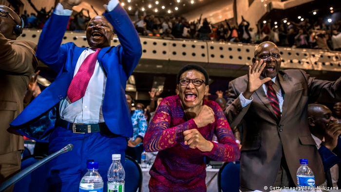 Lawmakers in Zimbabwe's parliament celebrate as Mugabe's resignation letter is read out
