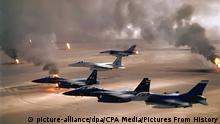 US aircraft fly over burning oilfields set alight by Iraqi troops retreating from Kuwait