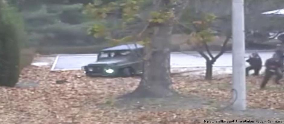 North Korean soldier running from a jeep