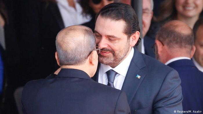 Saad al-Hariri, who announced his resignation as Lebanon's prime minister from Saudi Arabia greets Lebanese President Michel Aoun