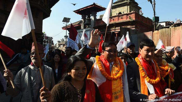Nepalis march in an election campaign