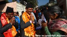 Nepali Congress and Democratic alliance election candidate Nabindra Raj Joshi (C) gestures as he takes part in a door-to-door in election campaign in Kathmandu on November 21, 2017. Nepal is gearing up for its first national elections in November under the new constitution, introduced as part of the peace deal that ended the country's brutal Maoist insurgency, cementing its transformation from a Hindu monarchy to a secular federal state. / AFP PHOTO / PRAKASH MATHEMA (Photo credit should read PRAKASH MATHEMA/AFP/Getty Images)