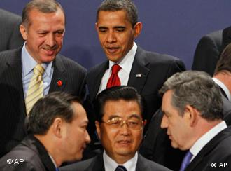 China's President Hu Jintao, front centre, surrounded by world leaders at the G-20 summit in London