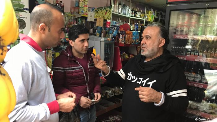 Khodor Hawilo talks to people in his Beirut shop