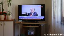 Former Bosnian Serb general Ratko Mladic is seen on a television screen in the home of one of the victims in Potocari near Srebrenica, Bosnia and Herzegovina, during his court proceedings at the International Criminal Tribunal for the former Yugoslavia (ICTY) in the Hague, November 22, 2017. REUTERS/Dado Ruvic