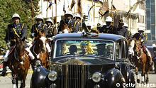 Zimbabwean President Robert Mugabe and his wife Grace arrive for the opening of the parliament in Harare 09 June 2005. Members of Zimbabwe's main opposition party, the Movement for Democratic Change (MDC), boycotted the opening of parliament as part of their nationwide strike against a controversial urban cleanup drive that has displaced several thousands. .AFP PHOTO / STR / AFP PHOTO / STR (Photo credit should read STR/AFP/Getty Images)