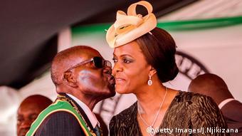 Robert Mugabe kisses Grace Mugabe on the cheek