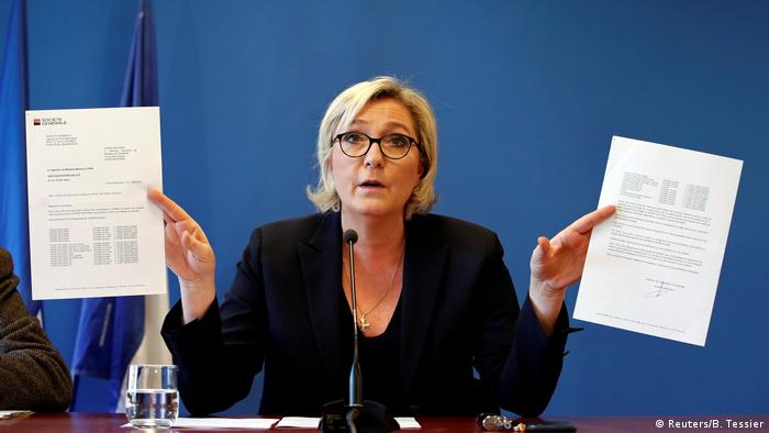 Marine Le Pen with her letters from the banks