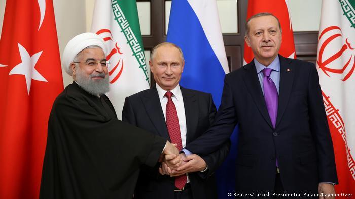 İran Cumhurbaşkanı Hasan Ruhani, Rusya Devlet Başkanı Putin ve Cumhurbaşkanı Erdoğan'ın bir araya geldiği Soçi zirvesi